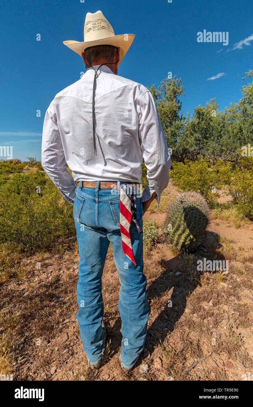 A ranch hand with an American flag handkerchief at White Stallion Ranch, a dude ranch outside Tucson, AZ. - Stock Image