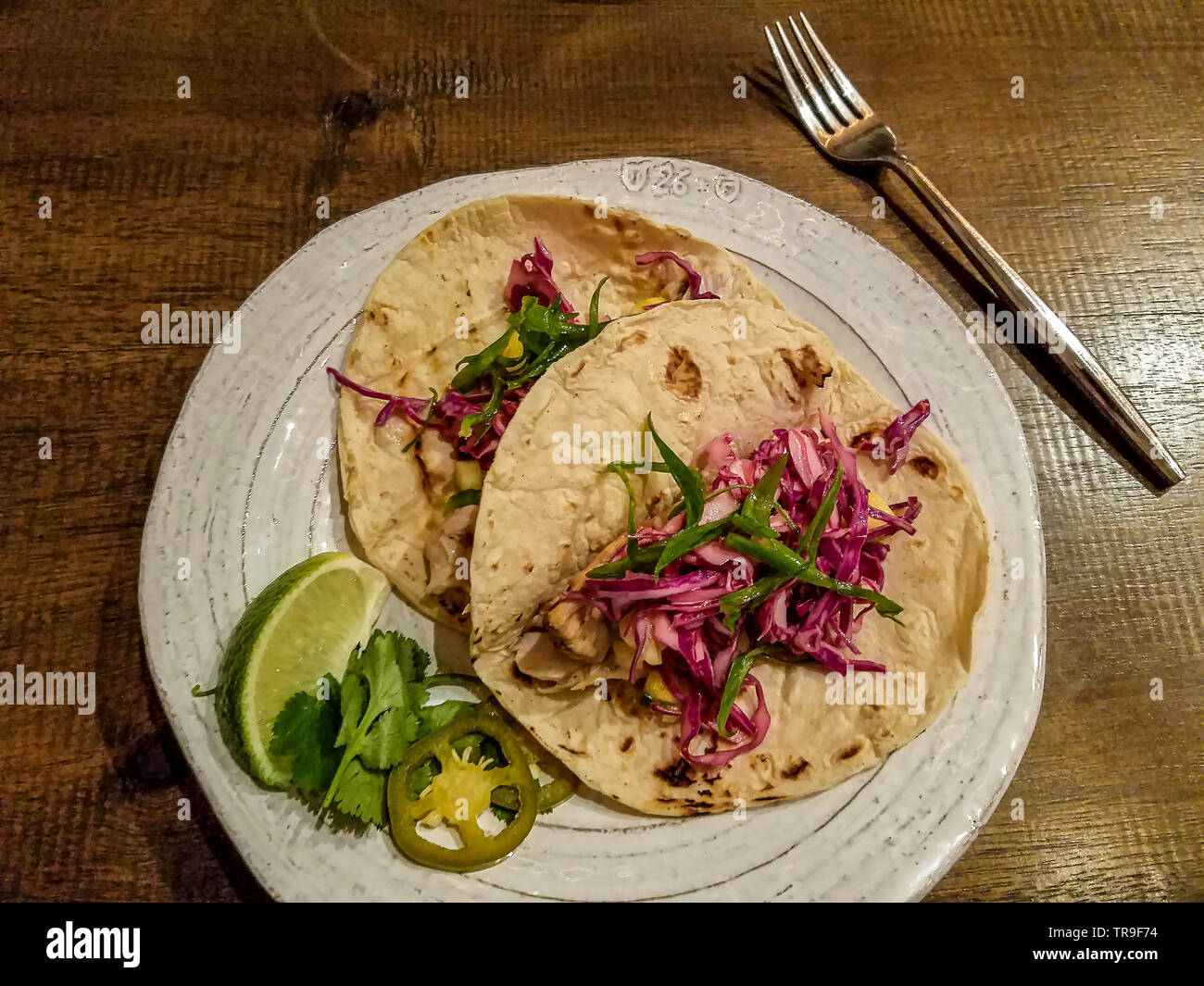 Grilled Mahi Tacos with shredded cabbage and lime. - Stock Image