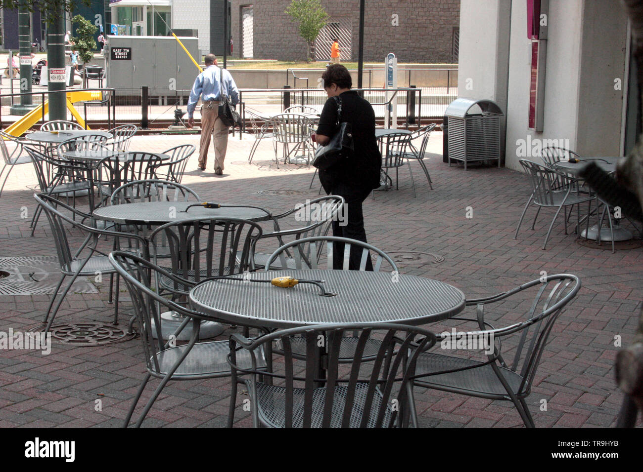 Restaurant Tables And Chairs Secured During Closing Hours In