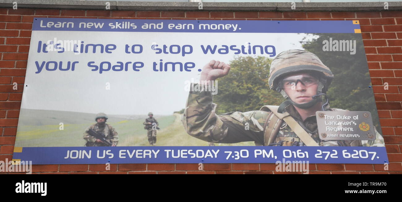 A banner invites people to join the Duke of Lancashire's Regiment Territorial Army in Ardwick, Manchester, uk - Stock Image