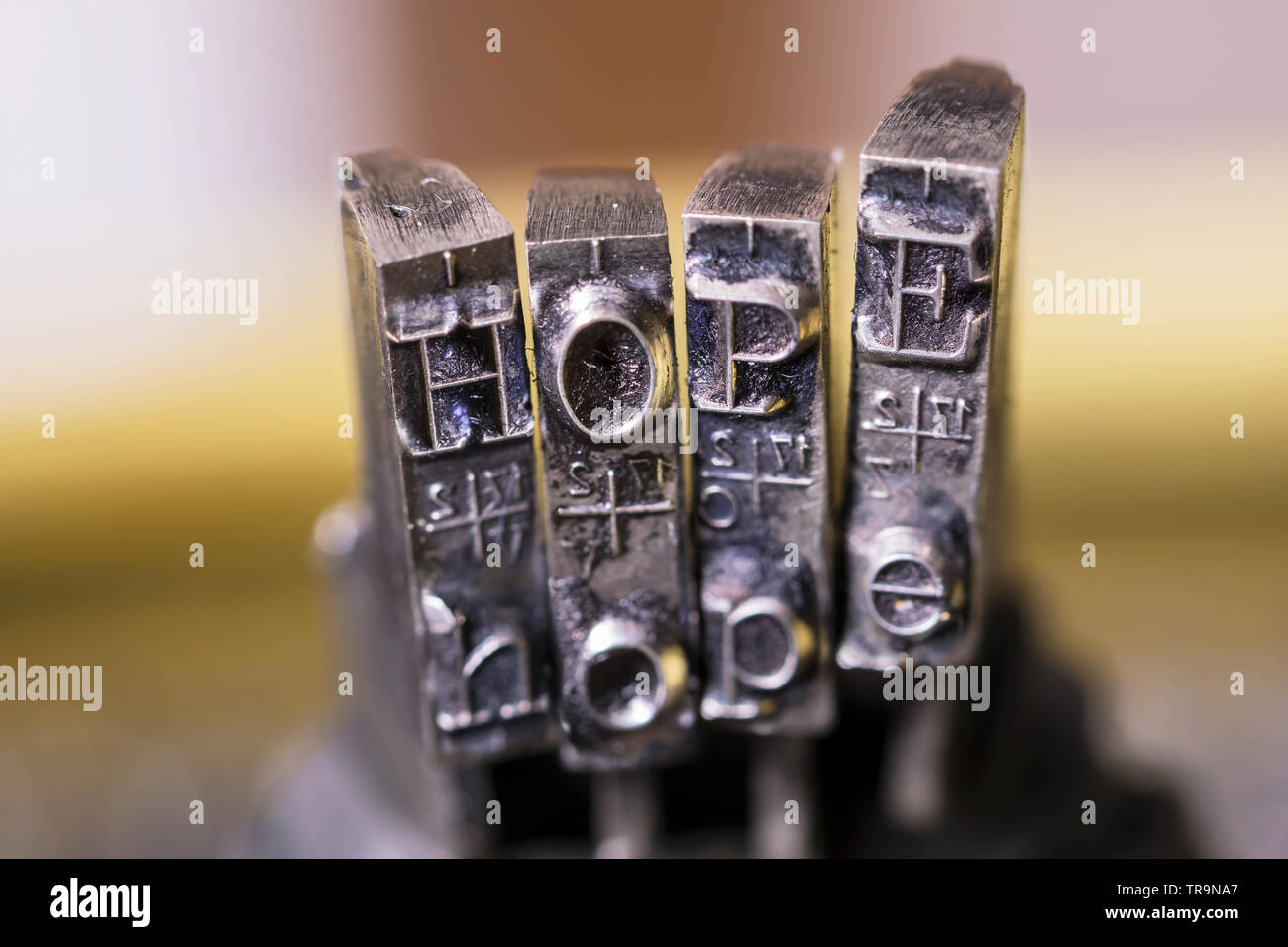 Macrophotography of typewriter hammers with HOPE word. - Stock Image