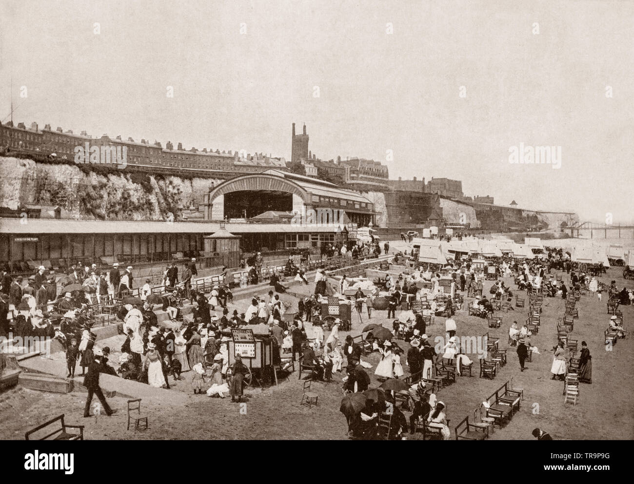 A 19th Century view of  the holiday makers on the sandy beach in Ramsgate, a seaside town in the district of Thanet in east Kent, England, famous for its glorious sands,  bathing, hotels, libraries, churches and  bracing climate. The architect A W Pugin and his sons lived in Ramsgate and built several important buildings there, including St Augustine's Church, The Grange, St Augustine's Abbey, and The Granville Hotel. - Stock Image