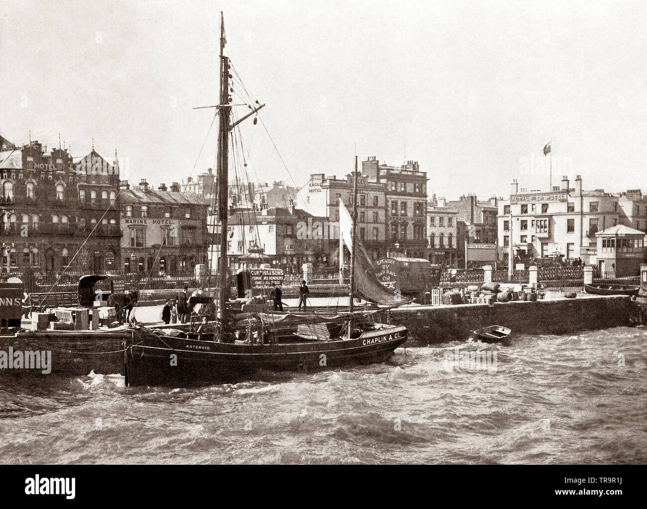A 19th Century view of a sailing ship moored against the Esplanade in Ryde, an English seaside town on the north-east coast of the Isle of Wight. It grew in size as a seaside resort after the villages of Upper Ryde and Lower Ryde were merged in the 19th Century. - Stock Image