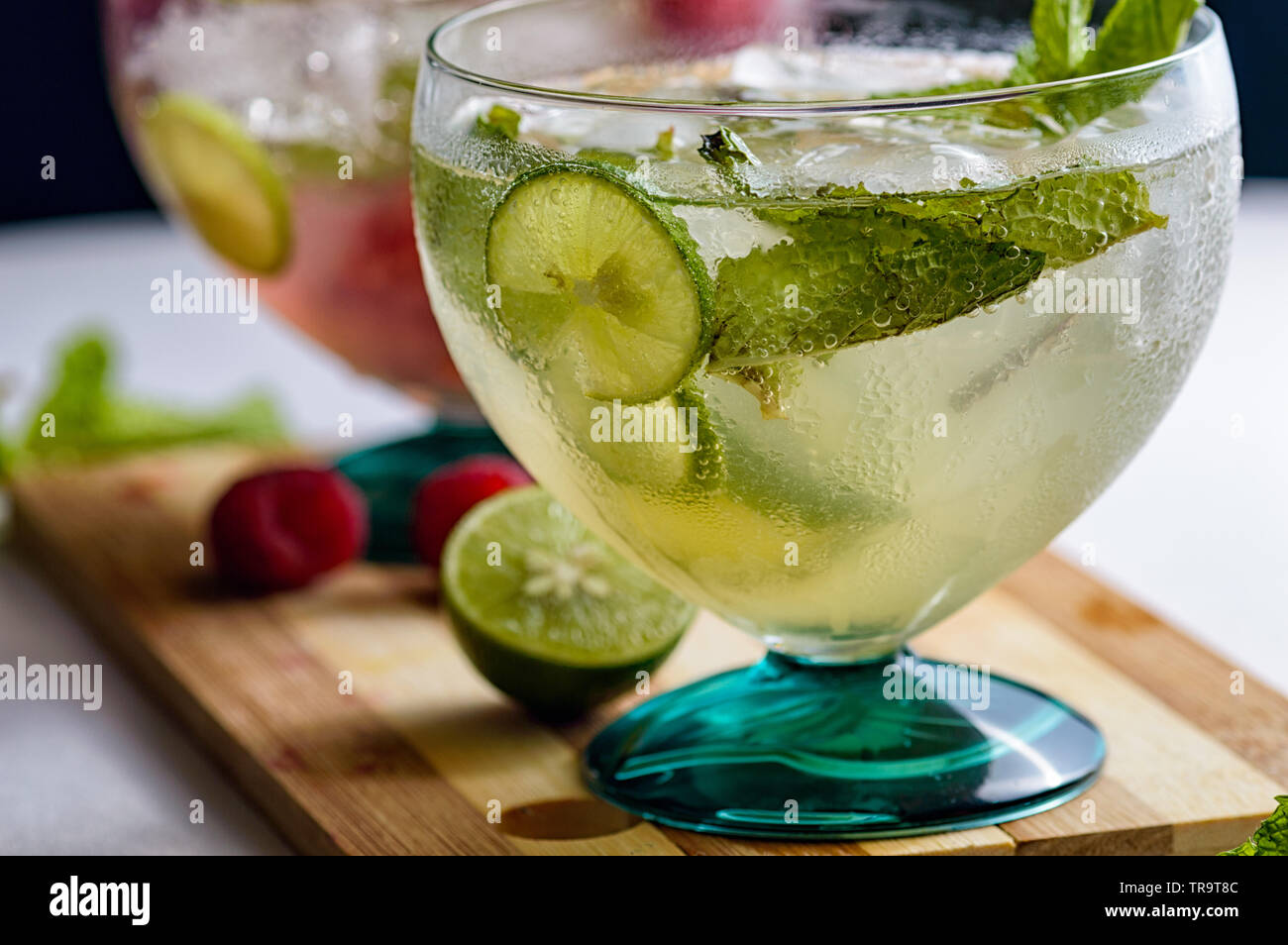 Mojito and raspberry mojito rum cocktail drinks with ingredients, limes, lemons, mint, brown sugar and raspberries. Concept for restaurants, food and - Stock Image