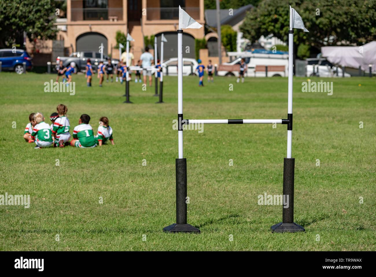 kids Australian football game half-time meeting - Stock Image