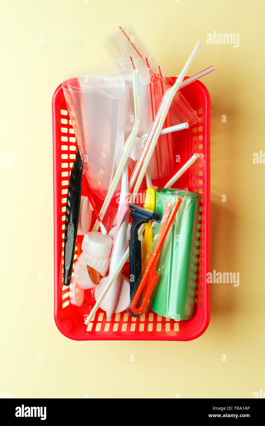 Plastic waste concept: variety of single use objects that get thrown out every day. Plastic shave, hygiene items and plastic package depicting ecologi - Stock Image