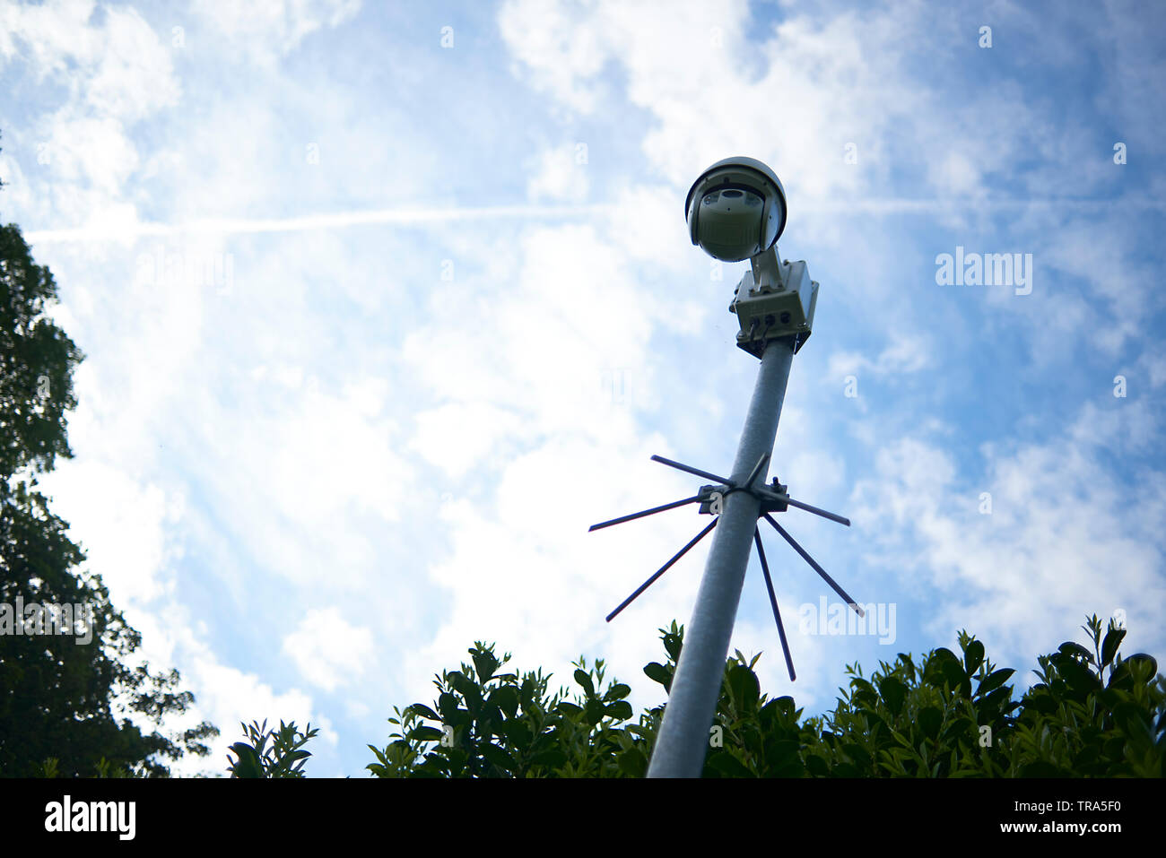 High tech camera up high on a pole recording and tracking the movement of people and stranger in order to protect the place - Stock Image