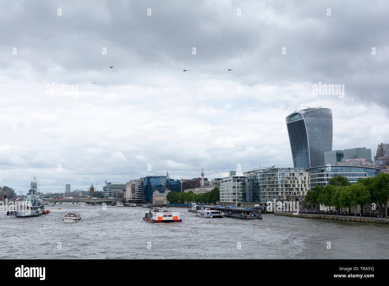 Helicopters from President Donald Trump's visit to London, surveying London's ever-changing skyline as new skyscrapers are added to the mix - Stock Image