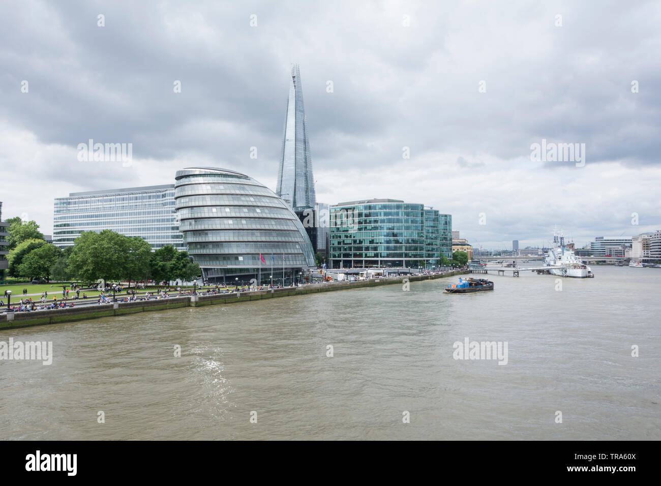 Norman Foster's London City Hall on the banks of the River Thames, London, UK - Stock Image