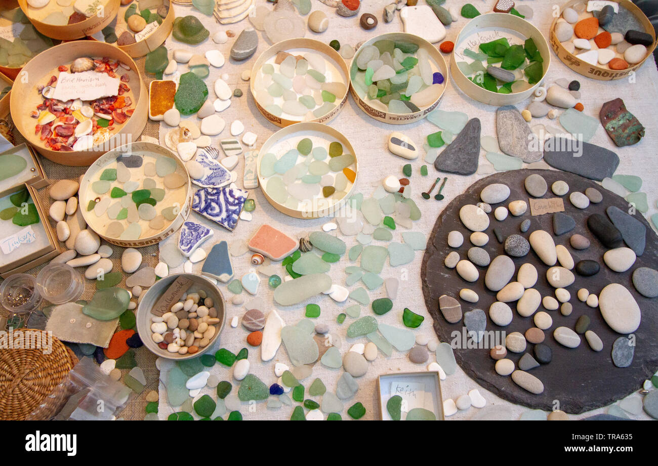 Found and made pieces scattered on a table top - Stock Image