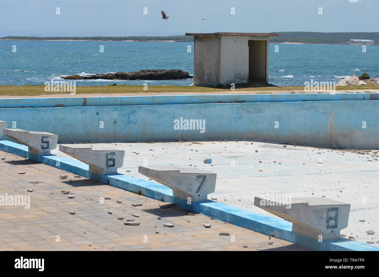 Derelict and empty swimming pool in Gibara, Southern Cuba - Stock Image