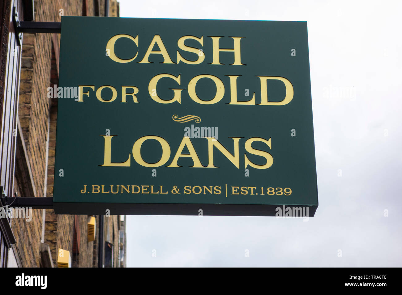 Sign advertising cash for gold and loans Hatton Garden London EC1 UK - Stock Image