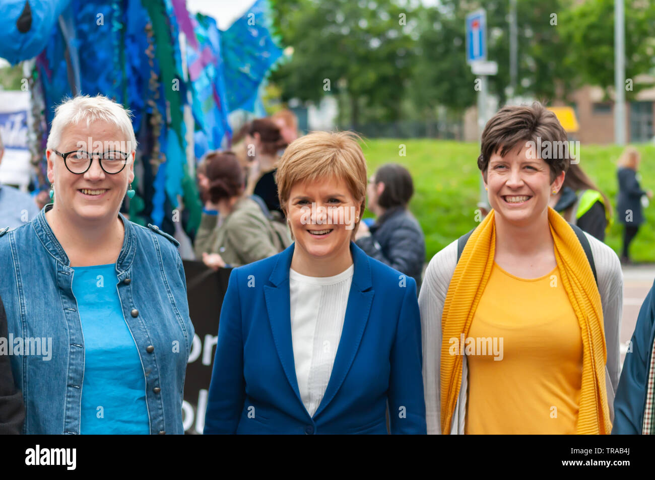 Glasgow, Scotland, UK. 1st June, 2019: Mhairi Hunter, SNP councillor for Glasgow Southside Central (left), Nicola Sturgeon MSP, the First Minister Of Scotland (middle) and Alison Thewliss MP (right) attend the annual Gorbals Fair which starts with a procession through the streets of The Gorbals. Credit: Skully/Alamy Live News Stock Photo