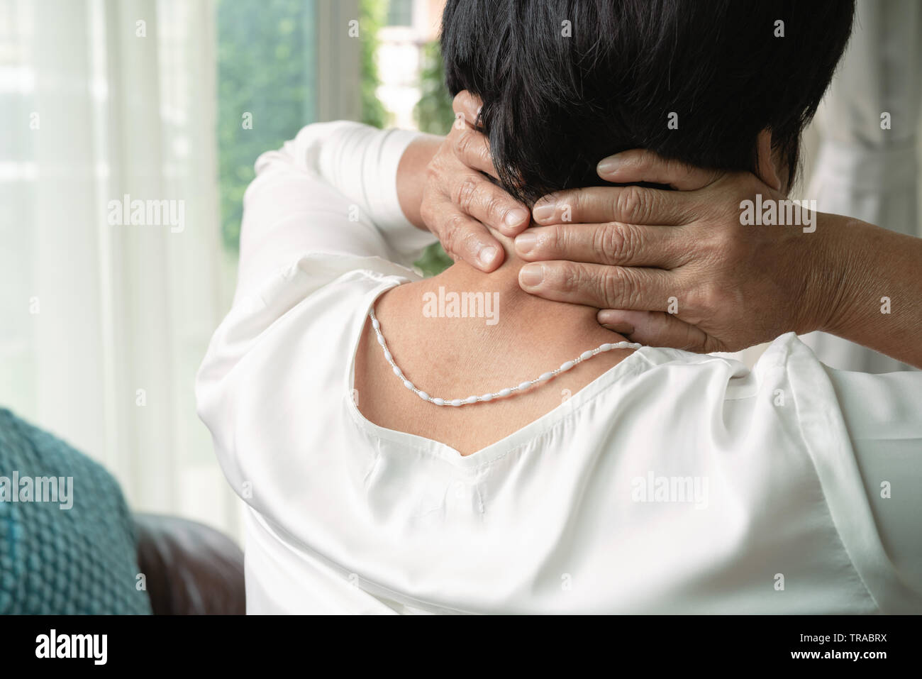 old woman suffering from neck pain, closeup, health problem concept - Stock Image