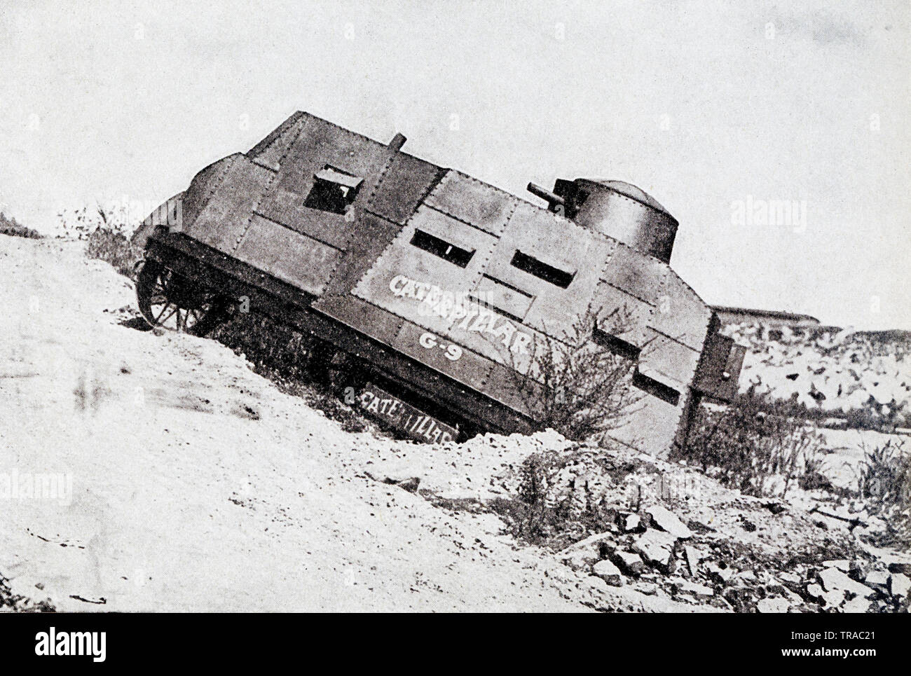 """This photo, dating to before 1922, relates to World War I. The caption reads: Caterpillar """"Tank"""" demonstrated to officers of army meets disaster. A model """"tank"""" constructed to be demonstrated to officers odf the United States Army turned a double somersault while climbing a bank after crossing the Los Angeles river, when the soft earrth gave way under the 13-ton machine. The demonstration, however, was successful, as it showed how easily a machine used in time of war can cross a river and climb its banks. The """"Tank"""" is modeled after those in actual service in Europe. - Stock Image"""