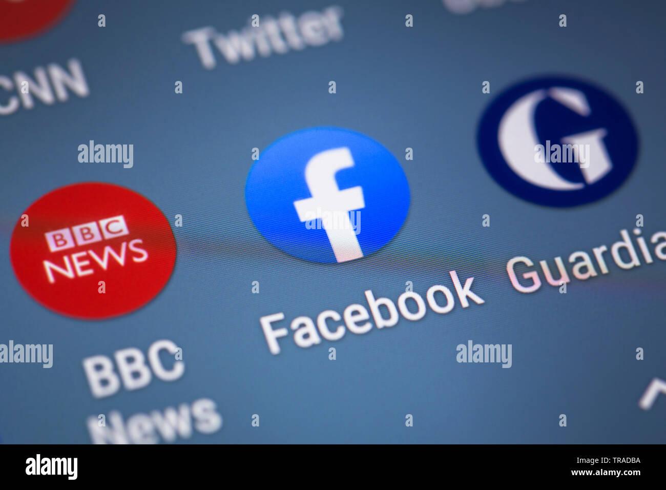 Facebook logo icon on mobile phone screen Stock Photo