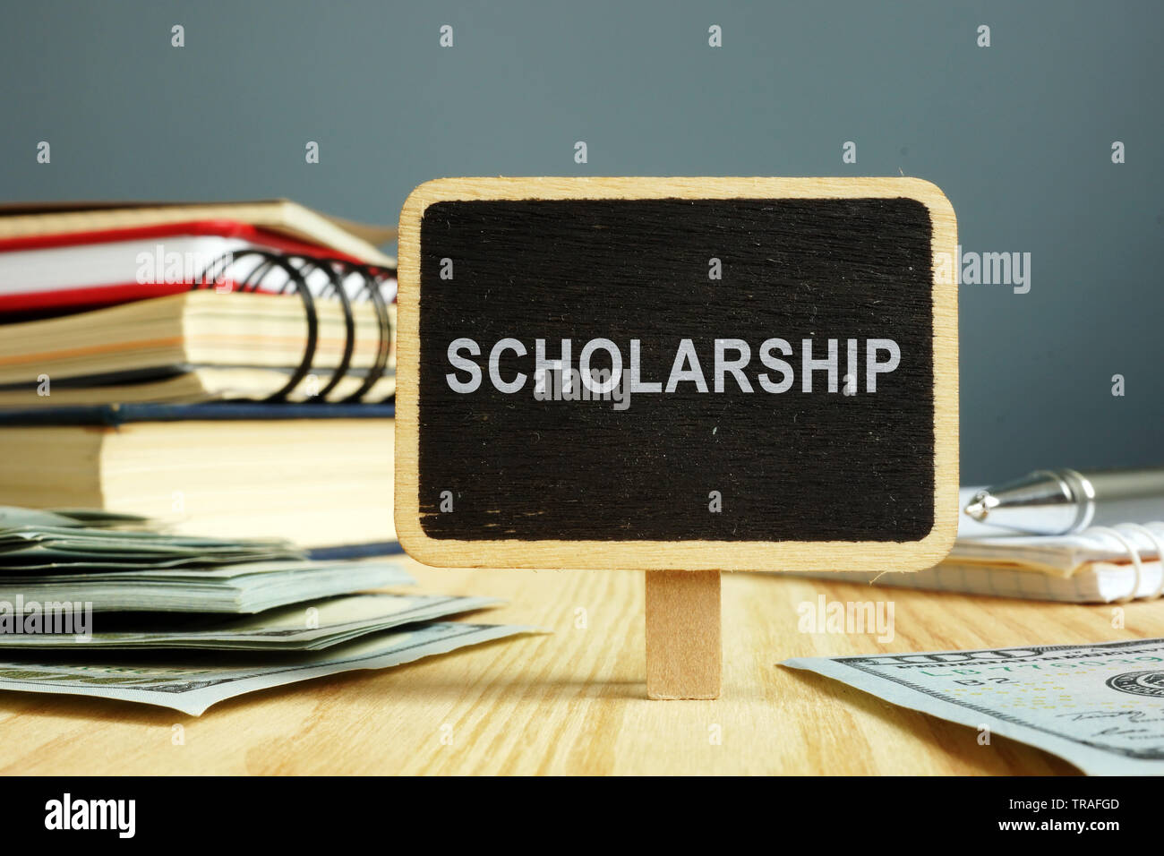 Scholarship concept. Notebooks and money for education. - Stock Image