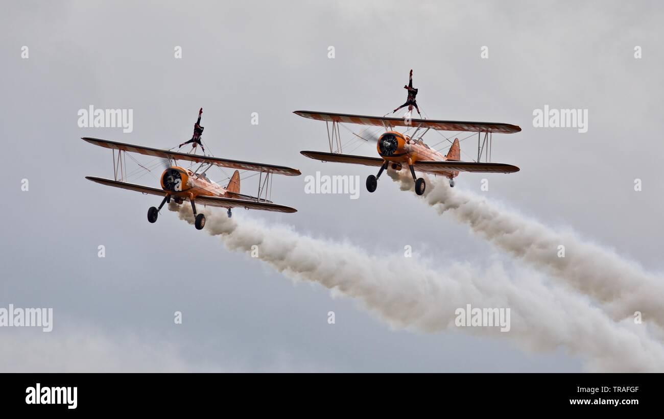 AeroSuperBatics Wingwalkers performing at the 2019 Duxford Air Festival - Stock Image