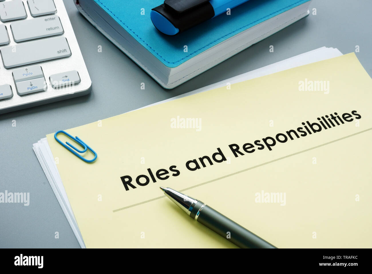 Roles And Responsibilities documents in the office. - Stock Image