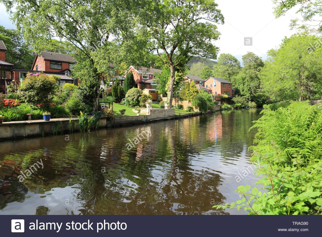Beautiful Homes Along The Canal At Greenfield Saddleworth UK - Stock Image