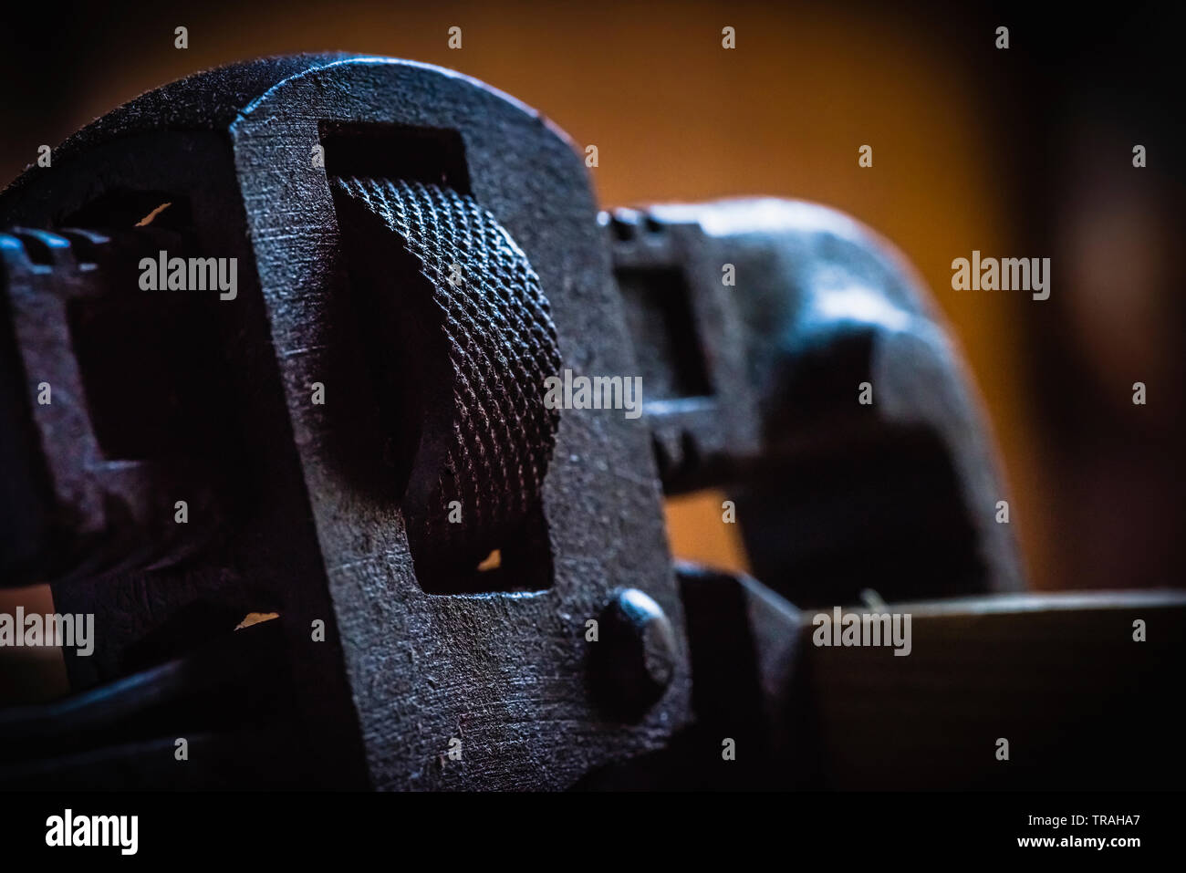 Concept view of stained pipe wrench hand tool in isolated background - Stock Image