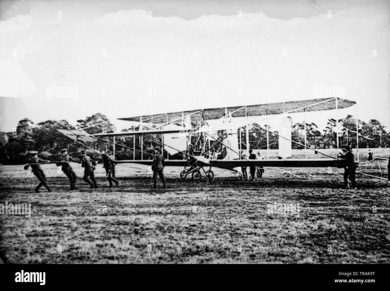 A black and white photograph taken in January 1909 showing a Cody Biplane being prepared for flight by members of the armed forces. This aircraft was known as British Army Aeroplane No. 1, or Cody 1. Designed  and built by Samuel Franklin Cody. - Stock Image
