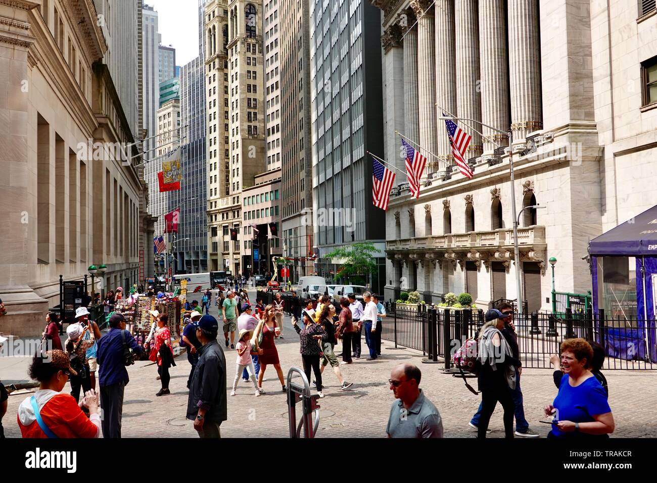 Tourists swarm the Broad Street Plaza in front of the New York Stock Exchange in on a June morning, Lower Manhattan, New York, NY, USA - Stock Image