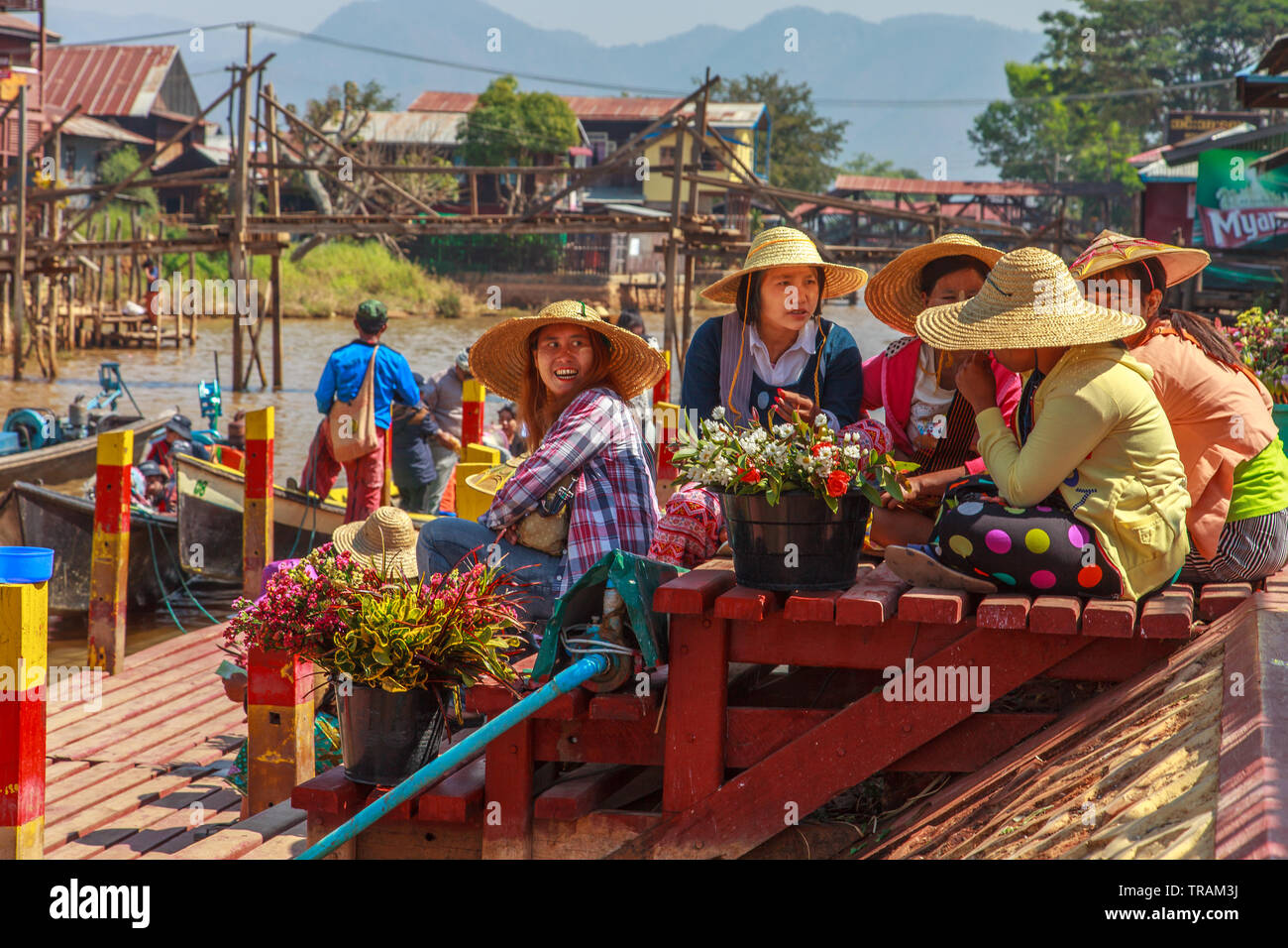 Flower sellers at the temple entrance, Inle Lake Myanmar Stock Photo