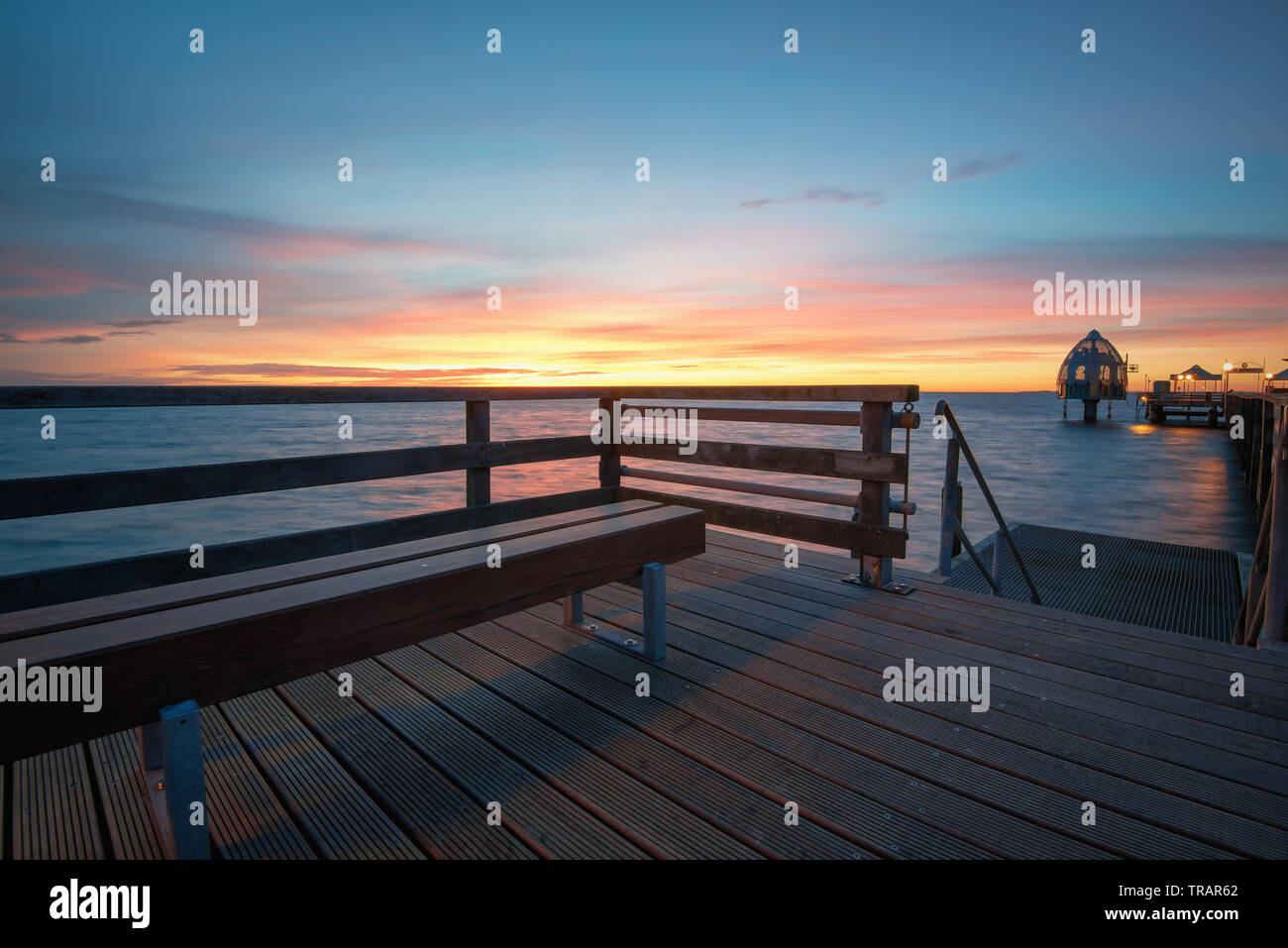 On the seabridge in grömitz during blue hour and calm sea Stock Photo