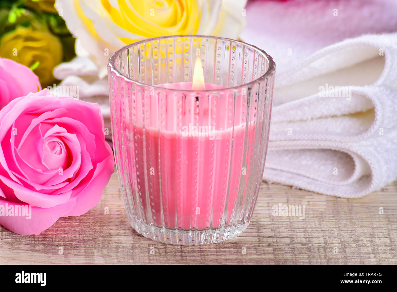 Spa composition with candles, flowers on ,wooden background. Stock Photo