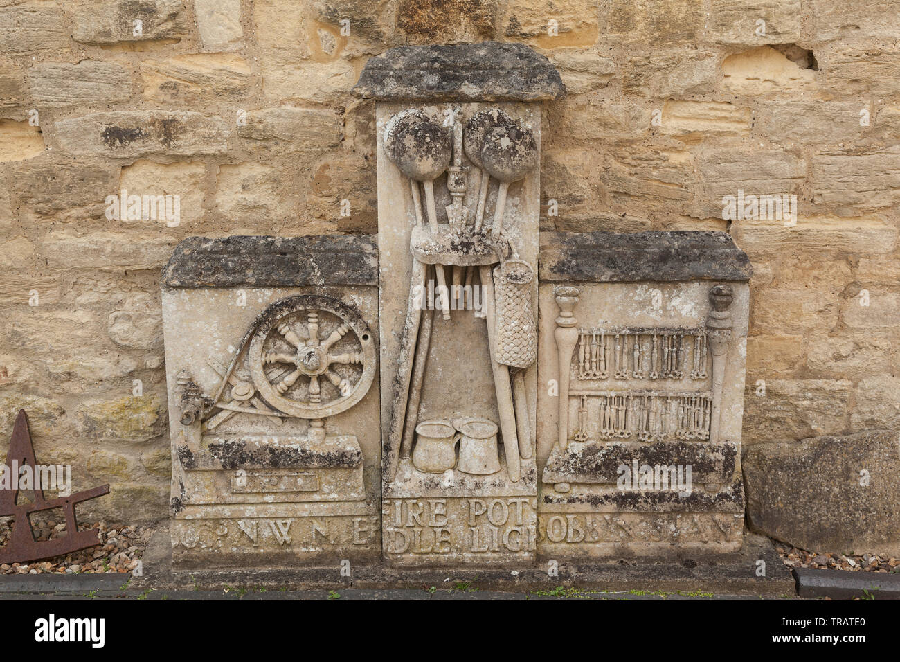 Stone carved images of spinning, weaving, lace making - Stock Image
