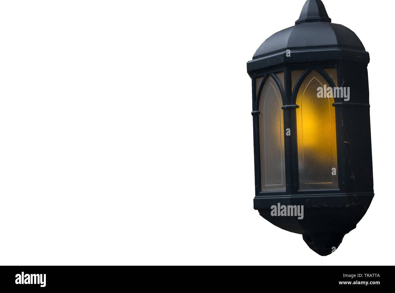 Lamps illuminate the evening attached to the house isolated over the white background. - Stock Image