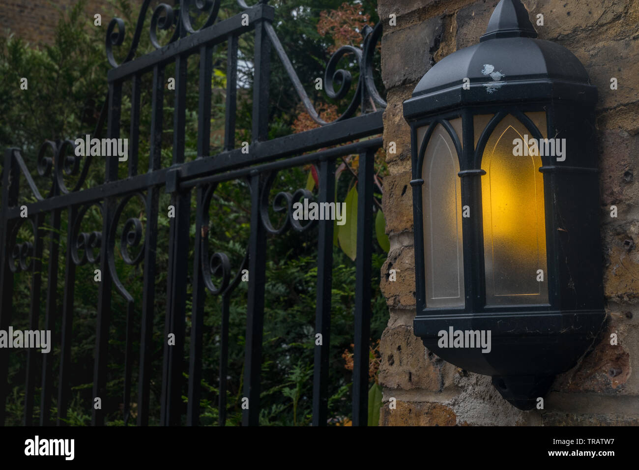 Lamps illuminate the evening attached to the house Suitable for background images. - Stock Image