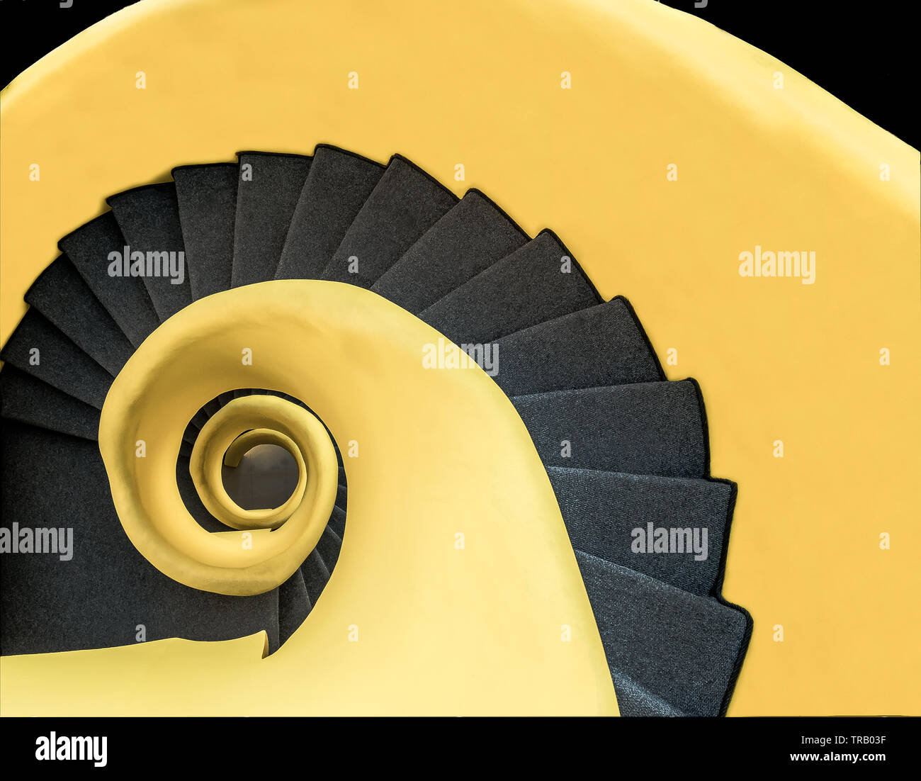 loud yellow spiral staircase - Stock Image