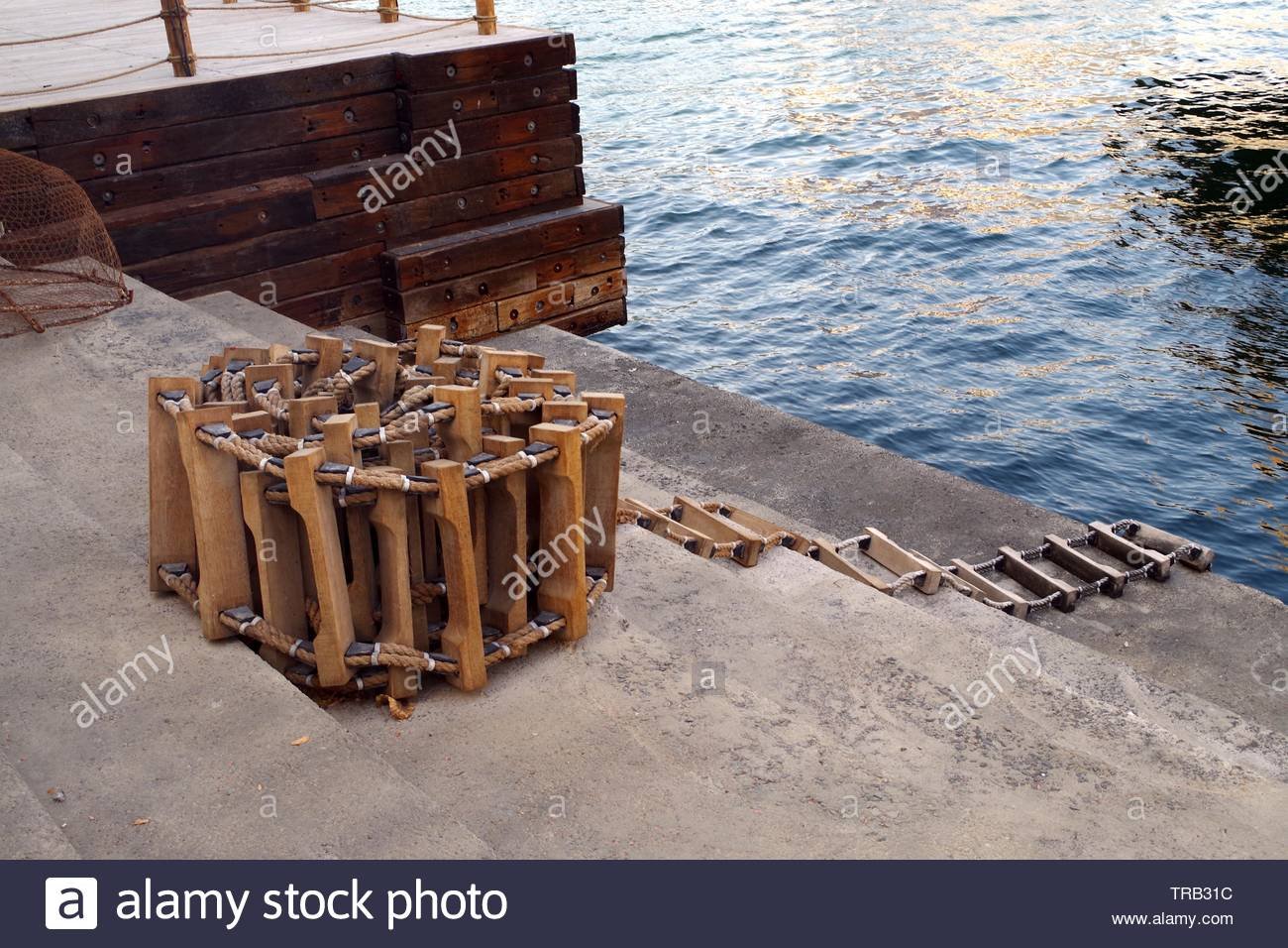 Picture of a marine ladder used to usually embark onboard boats while they are at sea, also called pilot ladder. Marine background. - Stock Image