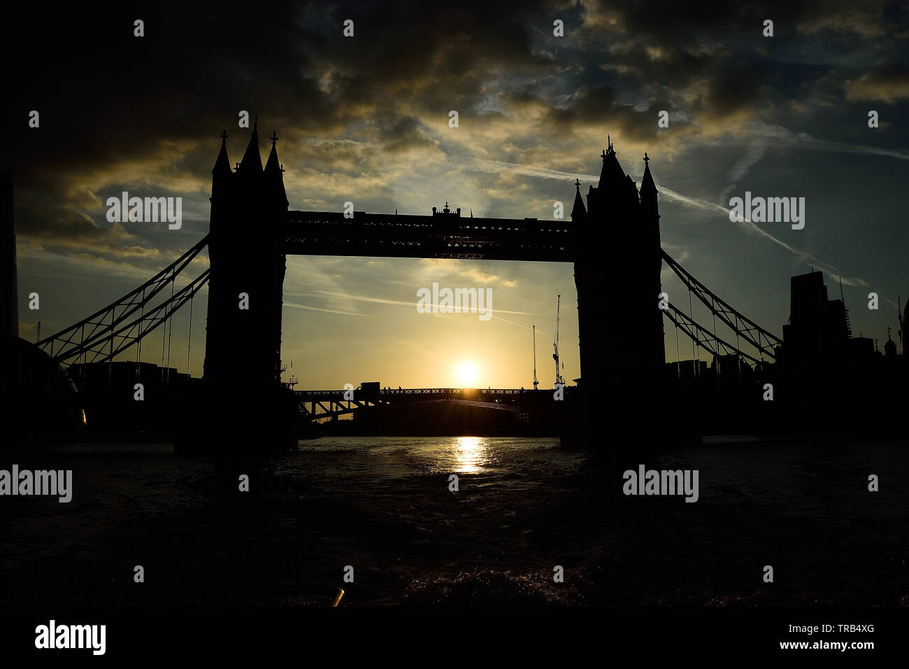 Tower Bridge, silhouetted on the London skyline taken from a Thames Clipper - Stock Image