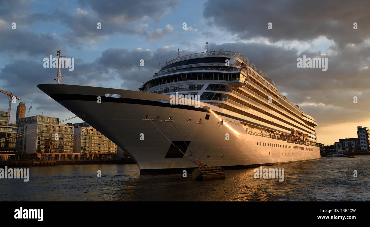 Cruise ship anchored on the River Thames, London taken from a river trip aboard a Thames Clipper. - Stock Image
