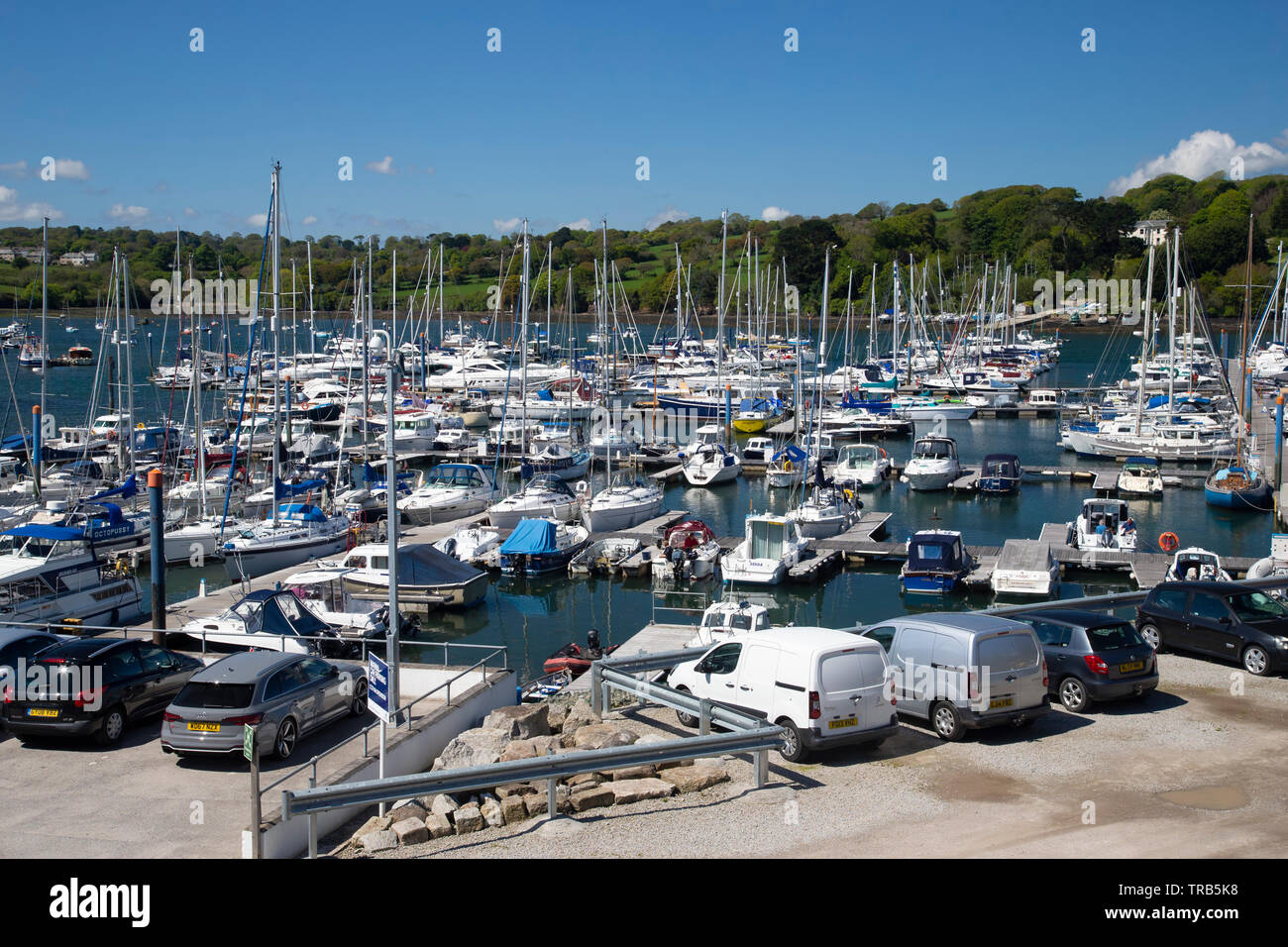 Falmouth Marina in Cornwall is one of the largest natural deep sea harbours in the world and in the sheltered waters of the Fal estuary - Stock Image