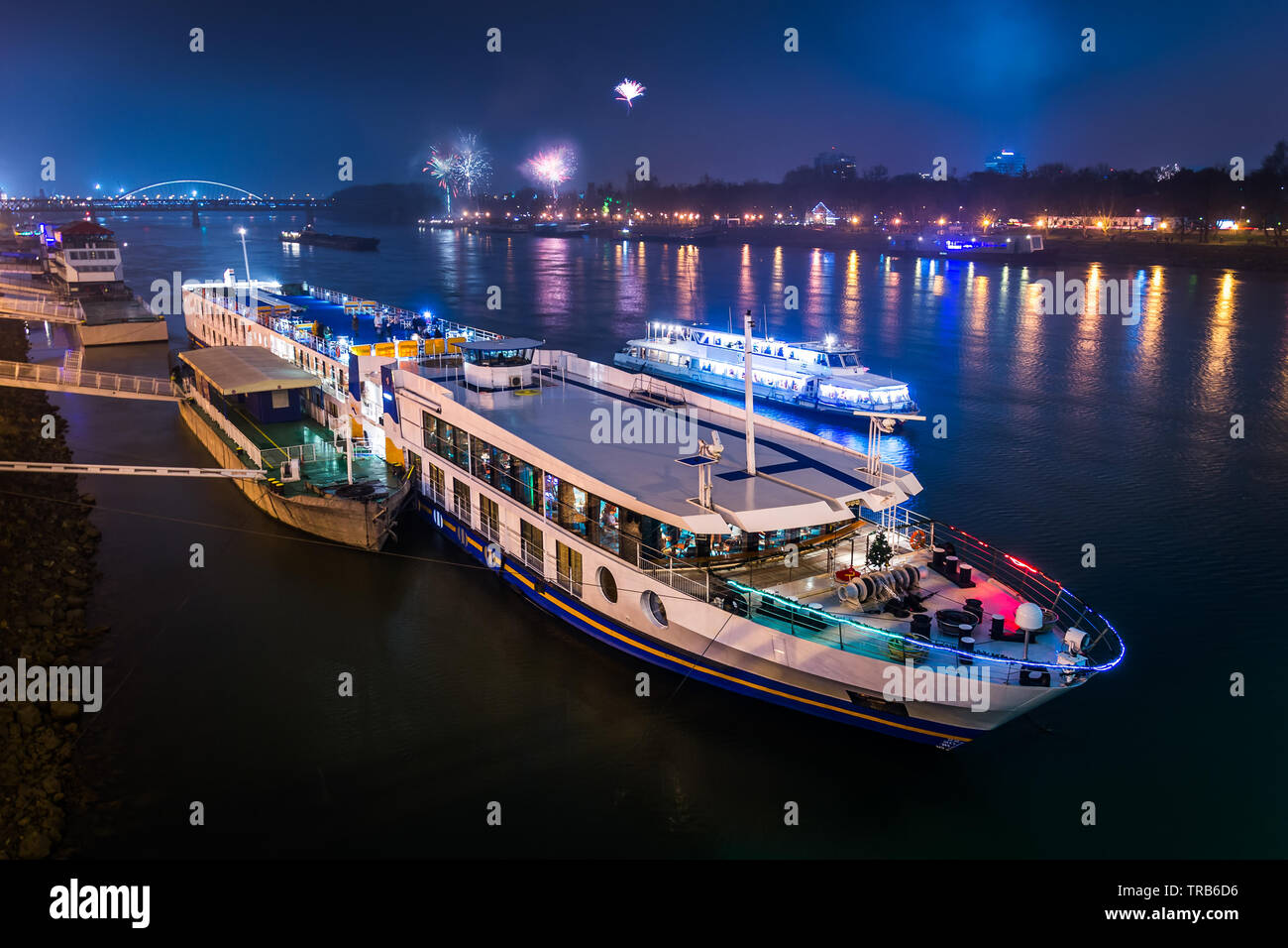 Passenger Boat on the Danube River with Fireworks in Background at Night - Stock Image