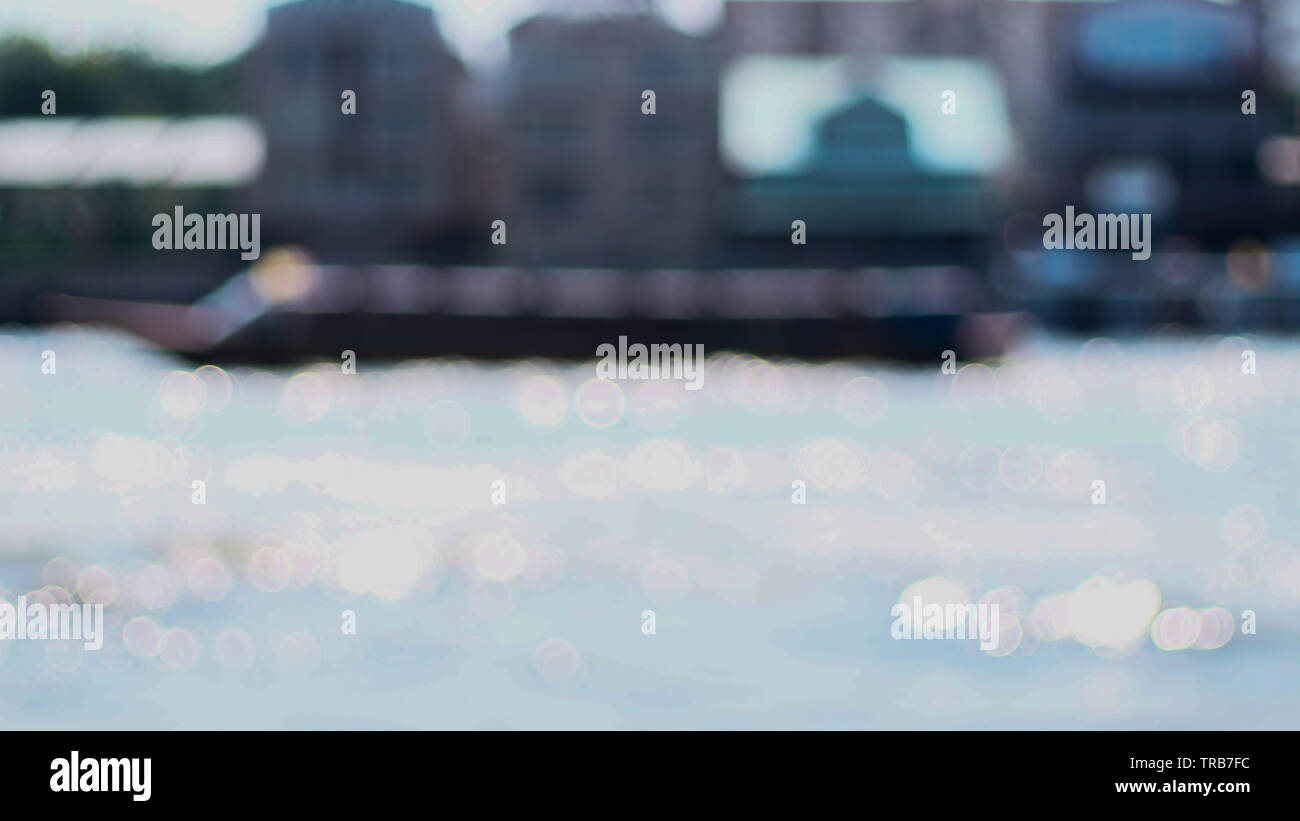 Blurred Bangkok city at Chao Phraya river bokeh reflection of water background. - Stock Image