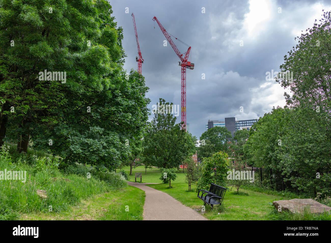Manchester, UK: Angel Meadow, in Victorian time a dense slum area described by Friedrich Engels as 'Hell upon Earth'. St Michael's Church was once her - Stock Image