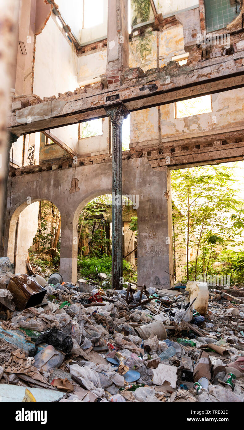 The inside of an old building that has fallen apart and is full of garbage in Havan Cuba. - Stock Image