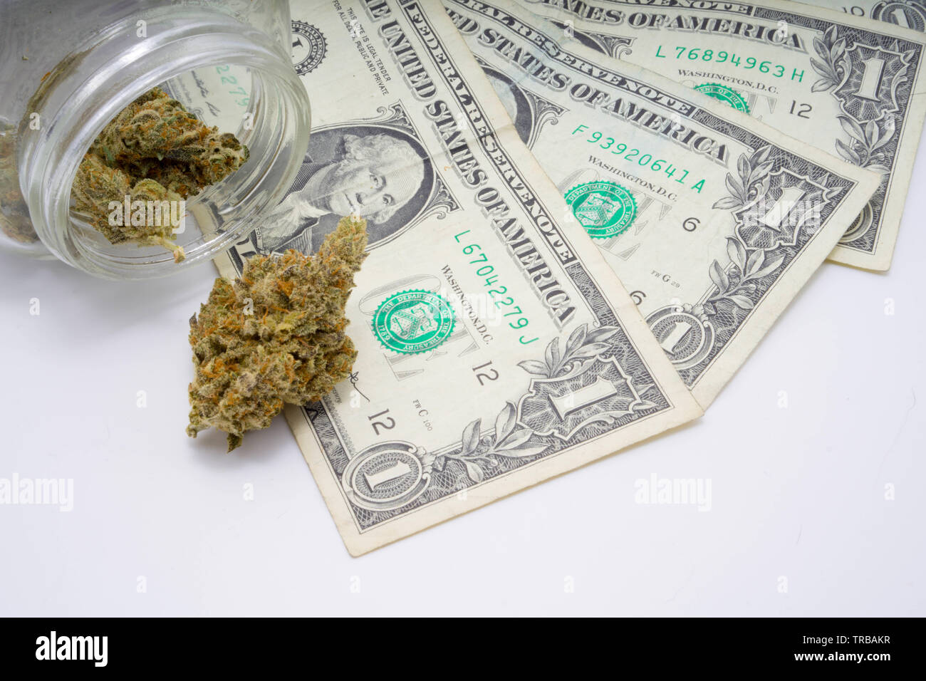 Money and marijuana concept for stock prices bullish and bearish - Stock Image
