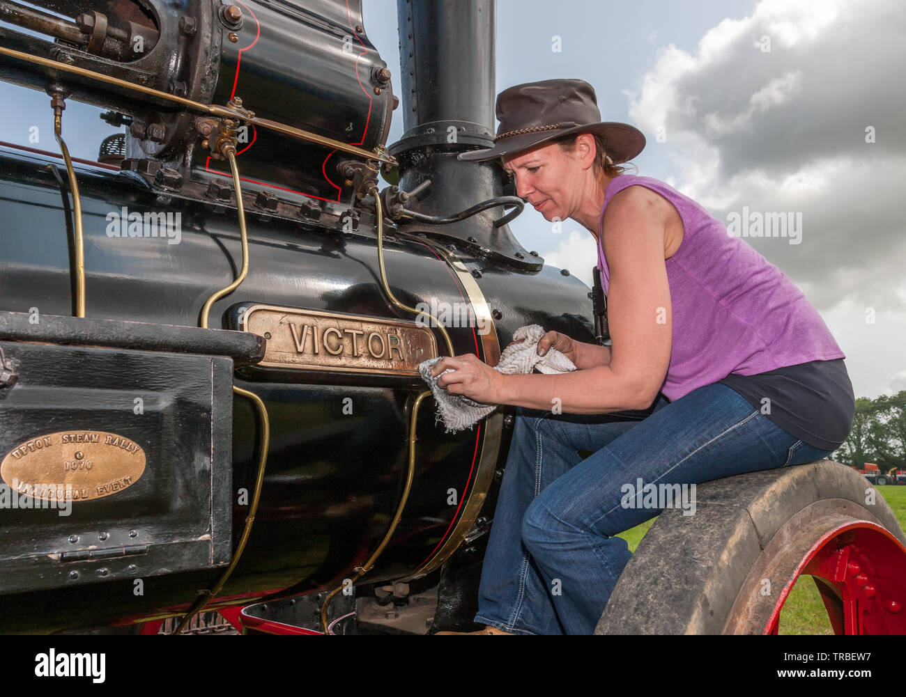 Innishannon, Cork, Ireland. 02nd June, 2019. Norma Lordan from Kilpatrick, polishing the brass name plate on a 1907 Marshall Engine which is taking part in the steam and vintage rally at Innshannon, Co. Cork, Ireland Credit: David Creedon/Alamy Live News Credit: David Creedon/Alamy Live News - Stock Image