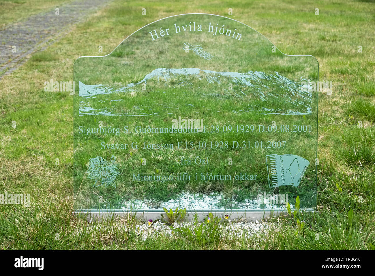 An etched plate glass gravestone at Þingeyrakirkja Church, near Blonduos in north Iceland - Stock Image