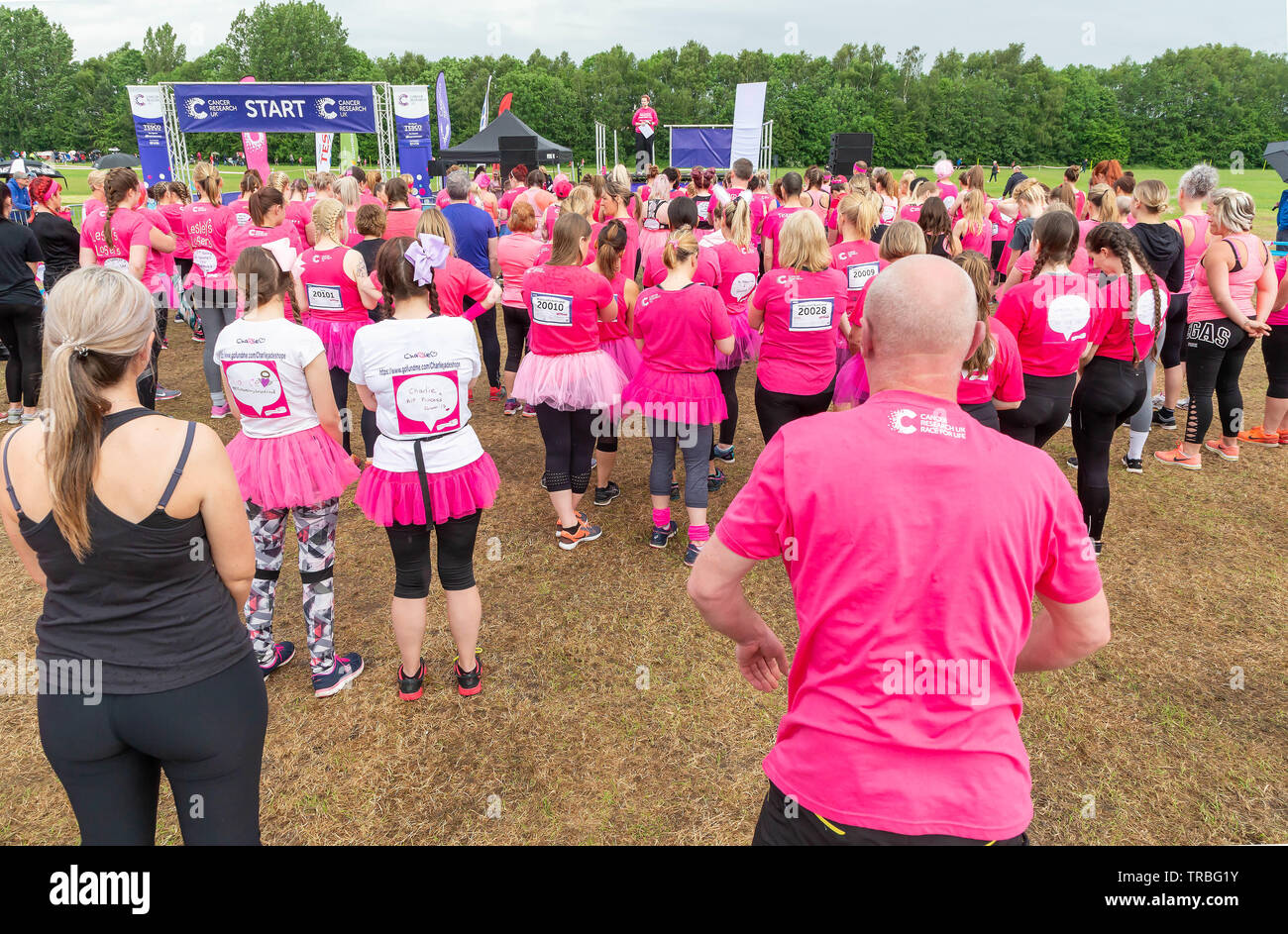 Warrington, UK. 2nd June 2019. Warrington, UK. 2nd June 2019. Race for Life 2019, Warrington, in aid of Cancer Research. Pre-race talk prior to the start of the race Credit: John Hopkins/Alamy Live News - Stock Image