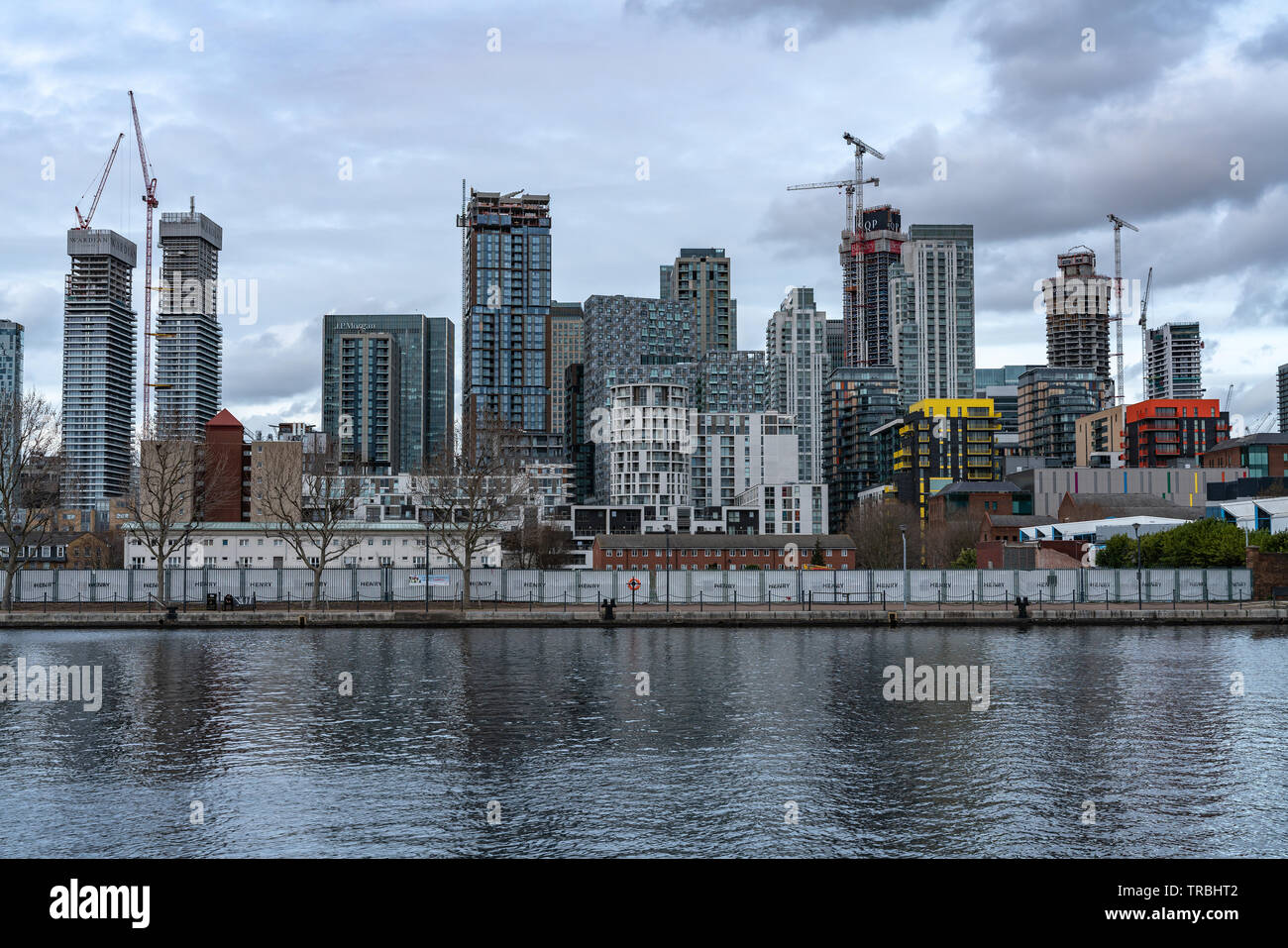 London, UK - March 05, 2019: New homes and developments, modern residential buildings on river Thames in Canary Wharf - Stock Image