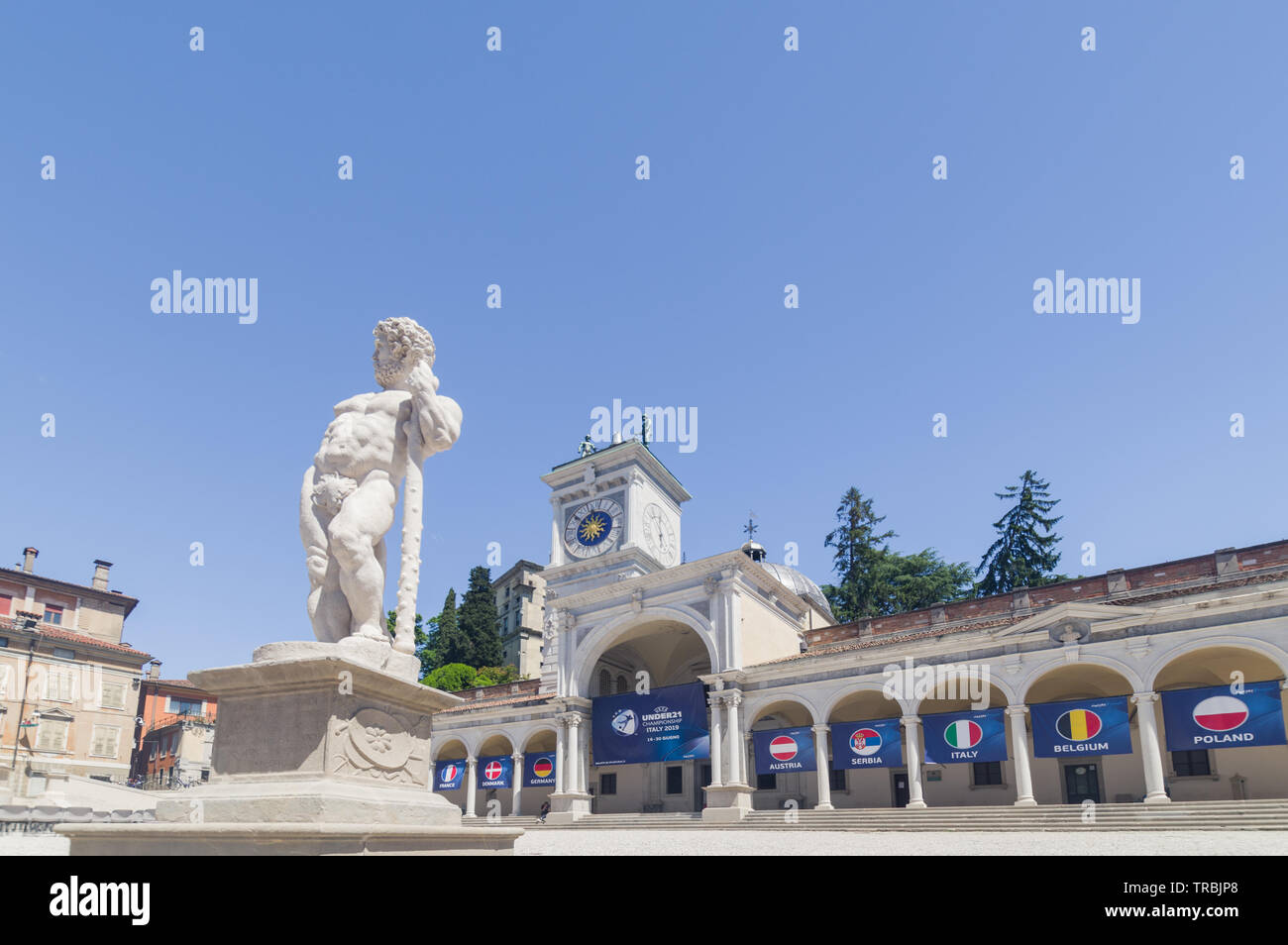 Udine, Italy  - Piazza della Libertà (Freedom Square) with the hanging flags of the nations of the 2019 U21 European football championship - Stock Image