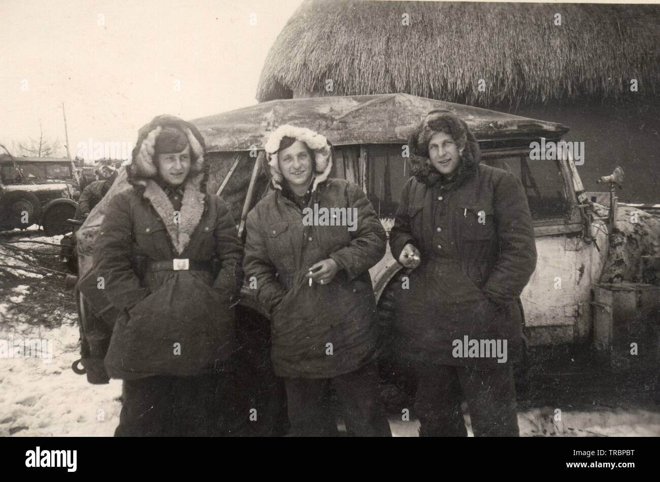 Waffen SS men in Winter Parkas pose in front of their