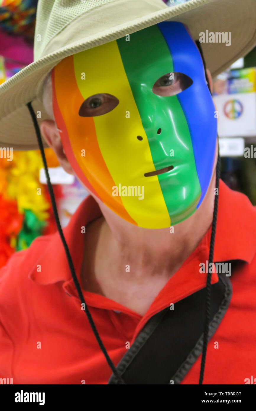 Man in a World pride Rainbow Mask, USA - Stock Image